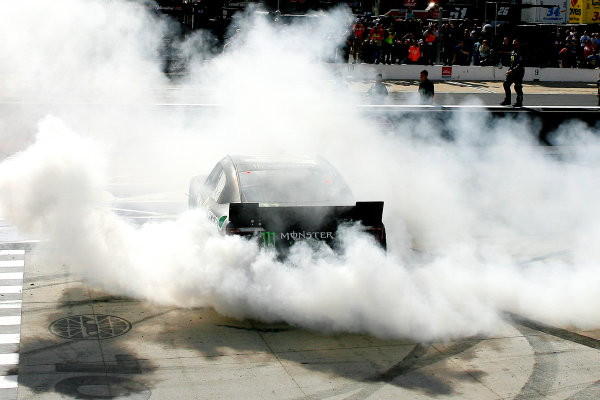 14-15 March, 2014, Bristol, Tennessee USA Kyle Busch, Monster Energy Toyota Camry celebrates his win with a burnout © 2014, Russell LaBounty LAT Photo USA