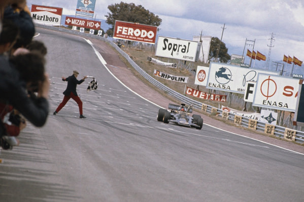 1972 Spanish Grand Prix.  Jarama, Spain. 29th April - 1st May 1972.  Emerson Fittipaldi, Lotus 72D Ford, 1st position, takes the chequered flag.  Ref: 72ESP04. World Copyright: LAT Photographic