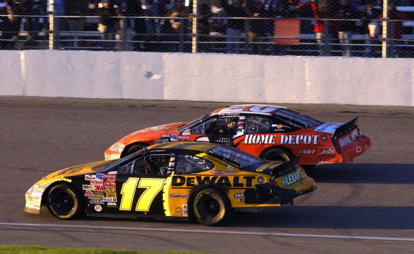 Matt Kenseth (USA), Smirnoff Ice/DeWalt Ford Taurus, (17) wins the 2003 Winston Cup. Tony Stewart (USA), Home Depot Chevrolet, passes him on the outside.