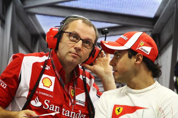 Stefano Domenicali (ITA) Ferrari General Director and Felipe Massa (BRA) Ferrari.  Formula One World Championship, Rd 14, Singapore Grand Prix, Qualifying Day, Marina Bay Street Circuit, Singapore, Saturday 24 September 2011.