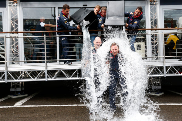 Spa-Francorchamps, Spa, Belgium. Saturday 23 August 2014. Adrian Newey, Chief Technical Officer, Red Bull Racing, and Christian Horner, Team Principal, Red Bull Racing. receive a soaking from Sebastian Vettel, Red Bull Racing, and Daniel Ricciardo, Red Bull Racing, after being nominated for the Ice Bucket Challenge. World Copyright: Alastair Staley/LAT Photographic. ref: Digital Image _R6T4856