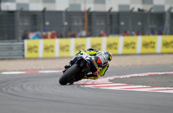 2014 MotoGP Championship  British Grand Prix.  Silverstone, England. 29th - 30st August 2014.  Valentino Rossi, Yamaha, drifts through Woodcote corner.  Ref: _W7_8450. World copyright: Kevin Wood/LAT Photographic