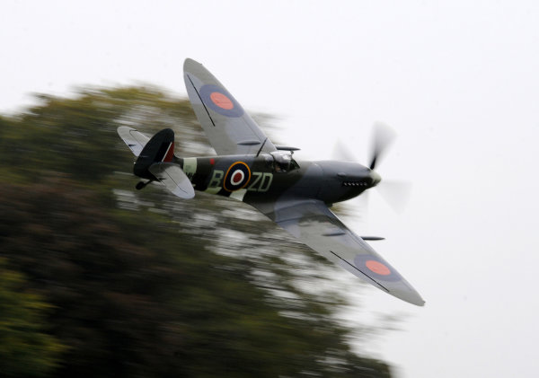 2014 Goodwood Revival Meeting Goodwood Estate, West Sussex, England 12th - 14th September 2014.  A Spitfire flies low over the cricket match.  World Copyright: Jeff Bloxham/LAT Photographic ref: Digital Image DSC_0121