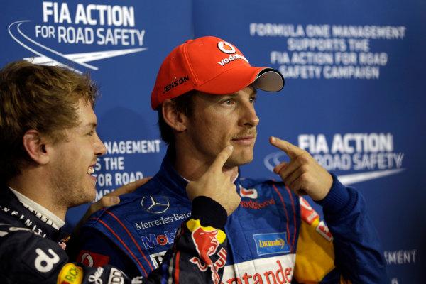 Yas Marina Circuit, Abu Dhabi, United Arab Emirates12th November 2011.Sebastian Vettel, Red Bull Racing RB7 Renault, points out Jenson Buttons moustache, presumably for Movember. Portrait. Atmosphere. World Copyright:Glenn Dunbar/LAT Photographic ref: Digital Image _G7C4607