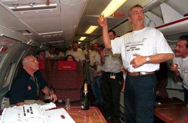 ITV Commentator Tony Jardine (Right) raises a toast for Murray Walker (left) aboard the European Aviation aeroplane after he commentated on his final European Grand Prix. 