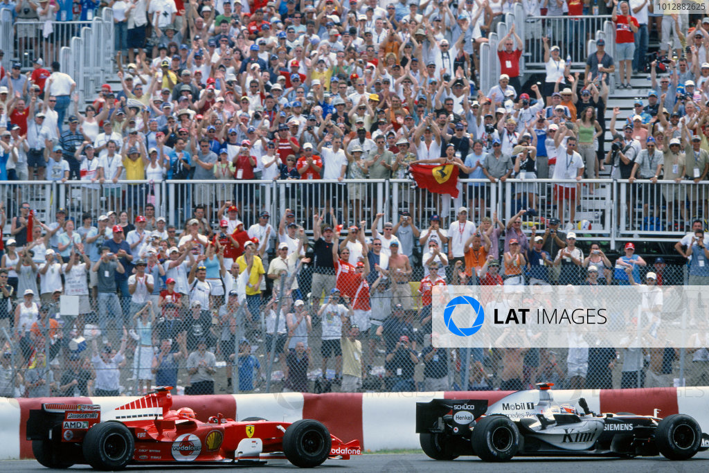2005 Canadian Grand PrixOn the celebration lap, race winner Kimi Raikkonen, McLaren Mercedes MP4-20 (1st) waves to the crowds, as he is followed by 2nd place finisher Michael Schumacher, Ferrari F2005. Action World Copyright: Charles Coates/LAT Photographic ref: 50mb 35mm Image 05Can17