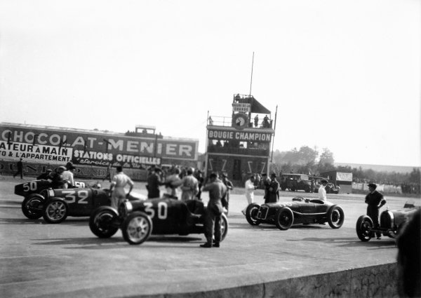 1931 French Grand Prix Montlhery, France. 21 June 1931 Cars form on the grid, left-to-right: Enzo Grimaldi/Borgait, Bugatti T35C, Louis Chiron/Achille Varzi, Bugatti T51, Earl Howe/Brian Lewis, Bugatti T51, and Robert Senechal, Delage 15S8. Chiron/Varzi finished in 1st position World Copyright: Robert Fellowes/LAT PhotographicRef: 31FRA01