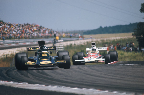 1974 French Grand Prix  Dijon-Prenois, France. 5-7th July 1974.  Jacky Ickx, Lotus 72E Ford, 5th position, leads Denny Hulme, McLaren M23 Ford, 6th position.  Ref: 74FRA02. World Copyright: LAT Photographic