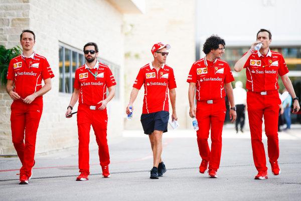 Circuit of the Americas, Austin, Texas, United States of America. Thursday 19 October 2017. Sebastian Vettel, Ferrari, with his team. World Copyright: Andy Hone/LAT Images  ref: Digital Image _ONZ5305