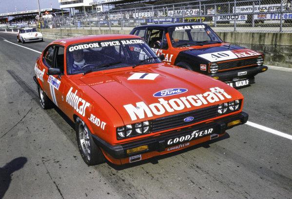 Gordon Spice, Ford Capri III 3.0S with Richard Lloyd, VW Golf GTi in the pit lane.