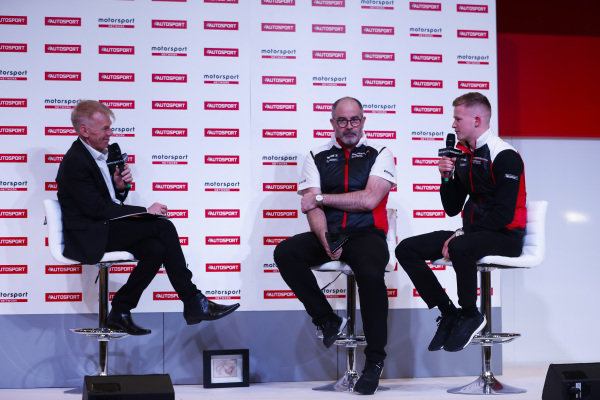 Dan Harper and James McNaughton of Porsche are interviewed on the Autosport Stage by Alan Hyde