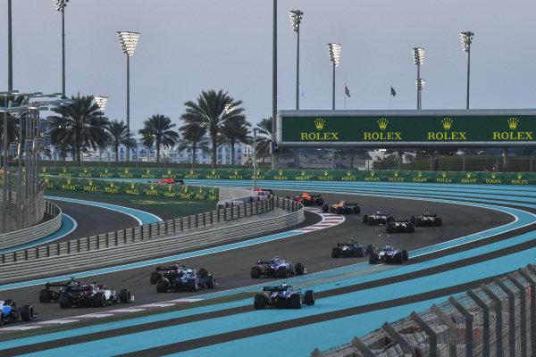 Alexander Albon, Red Bull RB15, leads Lando Norris, McLaren MCL34, Carlos Sainz Jr., McLaren MCL34, Daniel Ricciardo, Renault R.S.19, Nico Hulkenberg, Renault R.S. 19 and the rest of the pack at the start