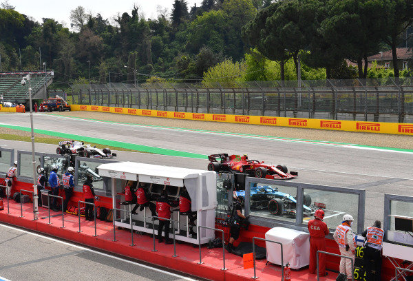 Fernando Alonso, Alpine A521, Carlos Sainz, Ferrari SF21, Pierre Gasly, AlphaTauri AT02, and Mick Schumacher, Haas VF-21, line up for practice starts at the end of FP3