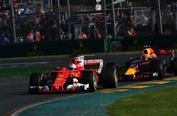 Sebastian Vettel (GER) Ferrari SF70-H leads Max Verstappen (NED) Red Bull Racing RB13 at Formula One World Championship, Rd1, Australian Grand Prix, Race, Albert Park, Melbourne, Australia, Sunday 26 March 2017.