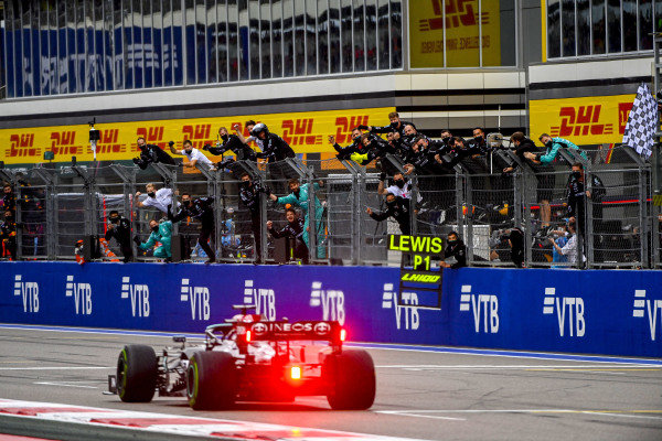 Sir Lewis Hamilton, Mercedes W12, 1st position, takes victory to the delight of his team on the pit wall