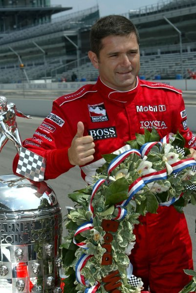 Gil de Ferran (BRA) Penske Racing G-Force Toyota celebrates his first Indy 500 victory with the famous trophy.Indy Racing League, Indianapolis 500, Indianapolis, USA, 26 May 2003.DIGITAL IMAGE