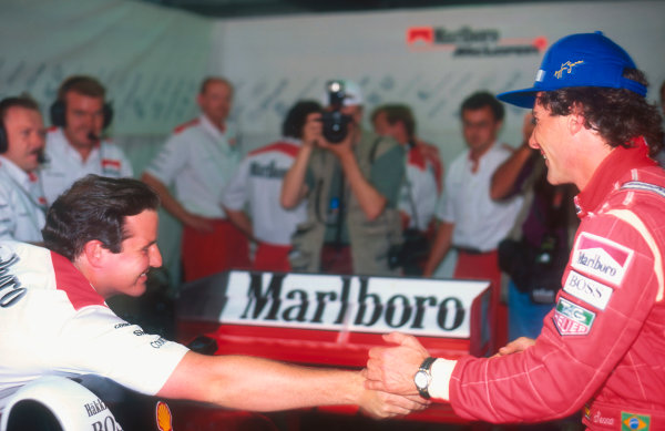 1993 Australian Grand Prix.Adelaide, Australia.5-7 November 1993.Ayrton Senna (McLaren Ford) is congratulated by team collegues after his 1st position, his last Grand Prix win.Ref-93 AUS 34.World Copyright - LAT Photographic