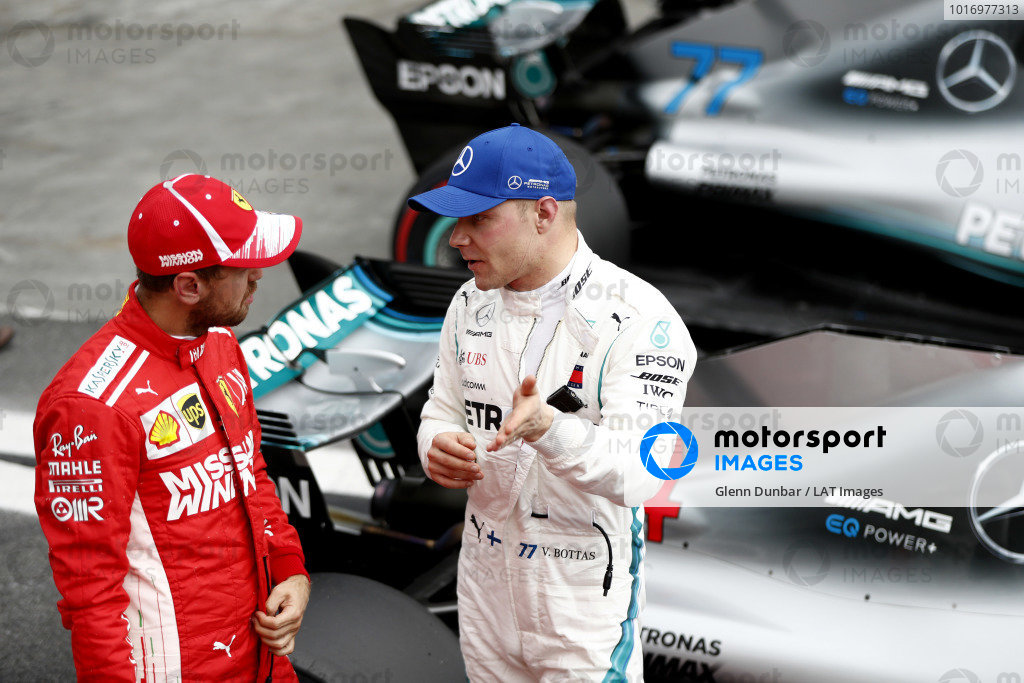 Sebastian Vettel, Ferrari, talks to Valtteri Bottas, Mercedes AMG F1, after Qualifying