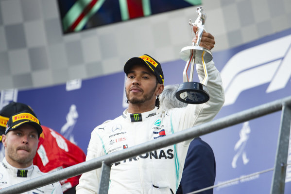 Lewis Hamilton, Mercedes AMG F1, 2nd position, with his trophy