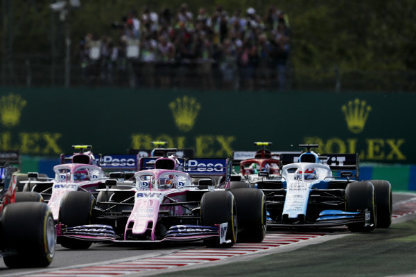 Sergio Perez, Racing Point, leads Lance Stroll, Racing Point, George Russell, Williams Racing, Antonio Giovinazzi, Alfa Romeo Racing, and the remainder of the field on the formation lap