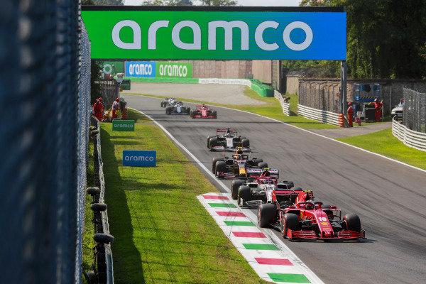 Charles Leclerc, Ferrari SF1000, leads Antonio Giovinazzi, Alfa Romeo Racing C39, Alexander Albon, Red Bull Racing RB16, and Romain Grosjean, Haas VF-20