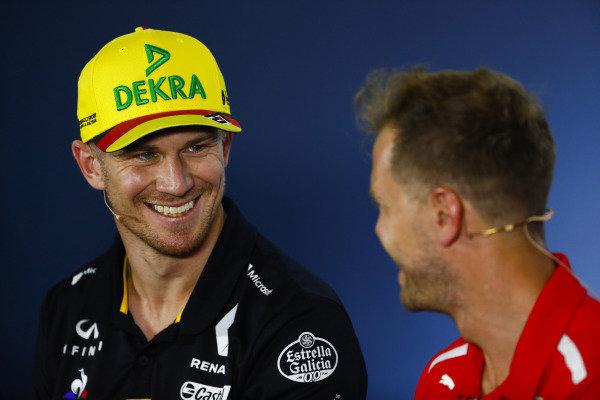 Nico Hulkenberg, Renault Sport F1 Team, and Sebastian Vettel, Ferrari, in the Thursday press conference.
