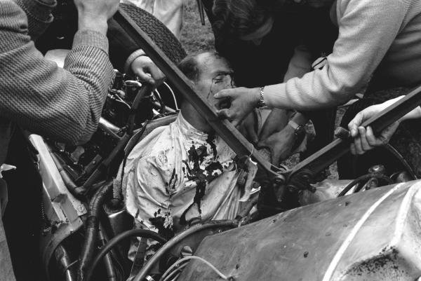 Stirling Moss (GBR) in the remains of the Lotus 18 Climax, the accident that ended his career at St Marys corner Goodwood Easter Monday F1 races, Glover Trophy, 23rd April 1962