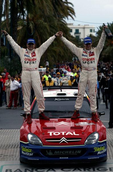 2003 FIA World Rally Champs. Round Eleven Sanremo Rally 2nd-5th October 2003.Sebastien Loeb (R) & co-driver Daniel Elena (L) celebrate victory, Citroen, podium. World Copyright: McKlein/LAT