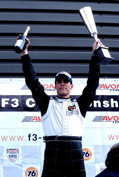 2003 British Formula Three ChampionshipSnetterton, England. 19th - 20th April 2003.Race winner Alan van der Merwe (Carlin Motorsports), podium.World Copyright: Glenn Dunbar/LAT Photographicref: 35mm Image