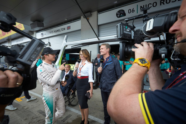 Red Bull Ring, Spielberg, Austria. Sunday 21 June 2015. Nico Rosberg, Mercedes AMG, 1st Position, is interviewed by BBC Sport F1's Suzi Perry and David Coulthard. World Copyright: Steve Etherington/LAT Photographic. ref: Digital Image SNE25069