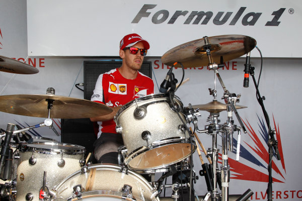 Silverstone Circuit, Northamptonshire, England. Saturday 4th July 2015 Sebastian Vettel, Ferrari on the drums World Copyright: Jakob Ebrey/LAT Photographic