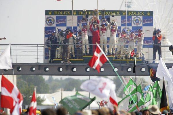2006 Le Mans 24 Hours, Le Mans, France.14th - 18th June. LMP1 Podium. F Biela (DEU)/ E Pirro (ITA)/ M Werner (DEU), Audi Sport Team Joest. and E Helary (FRA)/ S Loeb (FRA)/ F Montagny (FRA), Pescarolo Sport, Pescarolo Judd. and R Capello (ITA)/ T Kristensen (DNK)/ A McNish (GBR), Audi Sport Team Joest. Celebrate there win on the podium.World Copyright: Andrew Ferraro/LAT PhotographicRef: Digital Image Only ZP9O1512