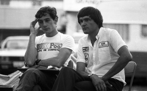 (L to R): Ayrton Senna da Silva (BRA) with West Surrey Racing Team Manager Dick Bennetts (NZL) mulls over his retirement from the race. British Formula Three Championship, Oulton Park, England, 6 August 1983.