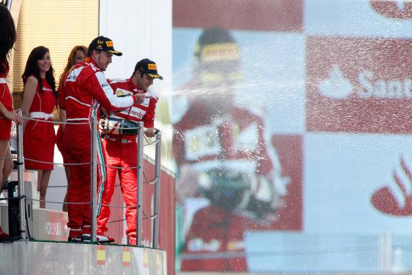 Circuit de Catalunya, Barcelona, Spain 12th May 2013 Fernando Alonso, Ferrari, 1st position, and Felipe Massa, Ferrari, 3rd position, spray Champagne from the podium. World Copyright: Steven Tee/LAT Photographic ref: Digital Image _14P2694