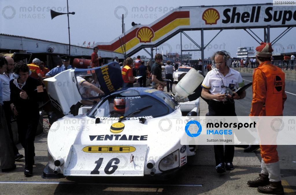 Eric Broadley (GBR) Lola Designer (right with clipboard) oversees the Lola T610 Ford of Guy Edwards (GBR) and Rupert Keegan (GBR) in the pits.