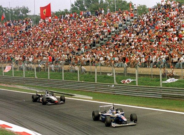 1997 Italian Grand Prix.Monza, Italy.5-7 September 1997.Jacques Villeneuve (Williams FW19 Renault) leads Mika Hakkinen (McLaren MP4/12 Mercedes-Benz) at Parabolica.World Copyright - Coates/LAT Photographic