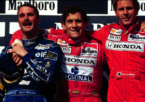 1992 Hungarian Grand Prix.Hungaroring, Budapest, Hungary.14-16 August 1992.Ayrton Senna with Gerhard Berger (both McLaren-Honda) and Nigel Mansell (Williams-Renault) after finishing in 1st, 3rd and 2nd positions respectively. Mansell clinched the World CHampionship.World - LAT Photographic