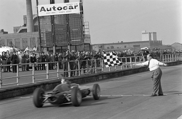Jim Clark, Lotus 24 Climax takes the chequered flag for victory.