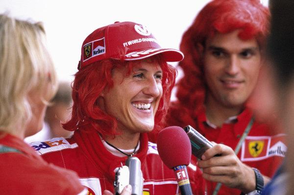 Michael Schumacher, Ferrari, is interviewed after the race.