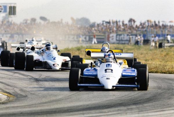 Jonathan Palmer, Ralt RH6/83H Mugen Honda, leads Alessandro Nannini, Minardi M283 BMW/Mader, and Philippe Streiff, AGS JH19B BMW/Mader.