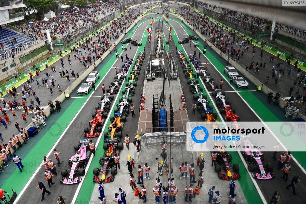 Fans invade the track towards Parc Ferme