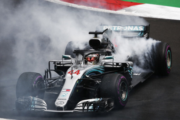 Lewis Hamilton, Mercedes AMG F1 W09 EQ Power+, performs donuts after securing his 5th world drivers championship title