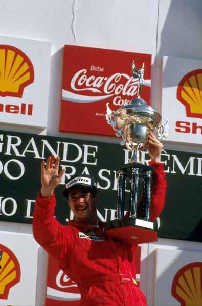 Jacarepagua, Rio de Janeiro, Brazil.24-26 March 1989.Nigel Mansell (Ferrari 640) 1st position on his debut race for Ferrari, celebrates on the podium.Ref-89 BRA 07.World Copyright - LAT Photographic