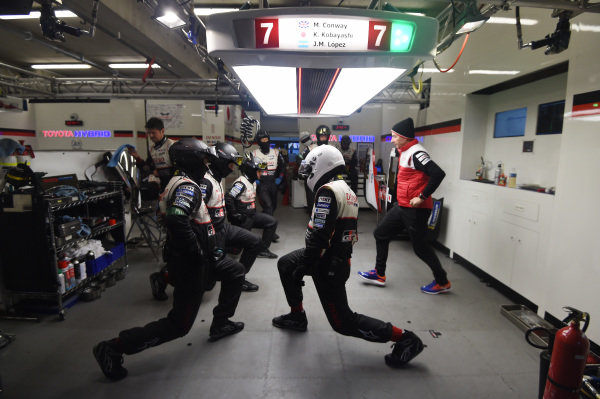 Toyota Gazoo Racing team members warm up before a pit stop
