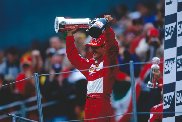 2000 United States Grand Prix. Indianapolis, Indiana, USA.  22-24 September 2000. Michael Schumacher (Ferrari) celebrates his 1st position on the podium. Ref-2K USA 45. World Copyright - LAT Photographic