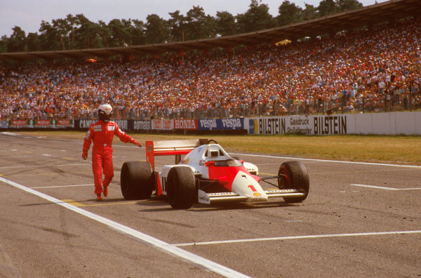 Hockenheim, Germany.25-27 July 1986.Alain Prost (McLaren MP4/2C TAG Porsche) ran out of fuel on the last lap and dropped from 3rd to 6th position, as he pushes his car across the finish line.Ref-86 GER 13.World Copyright - LAT Photographic