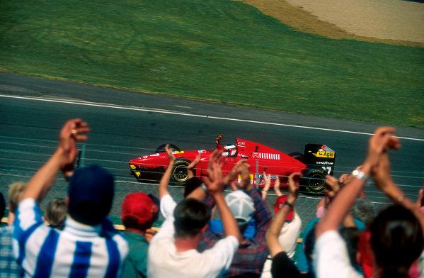 1994 British Grand Prix.Silverstone, England.8-10 July 1994.The crowd applaud Jean Alesi (Ferrari 412T1) 2nd position.Ref-94 GB 29.World Copyright - LAT Photographic