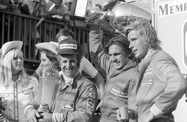Race winner Carlos Reutemann with Denny Hulme, 2nd position, and James Hunt, 3rd position.
