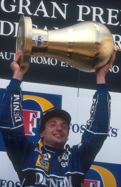 1990 San Marino Grand Prix.Imola, Italy.11-13 May 1990.Riccardo Patrese (Williams Renault) holds his trophy aloft as he celebrates 1st position on the podium.Ref-90 SM 04.World Copyright - LAT Photographic