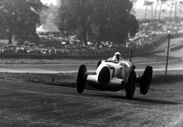 1937 Donington Grand Prix.Donington Park, Great Britain.2 October 1937.Hermann Muller (Auto Union C-typ), 4th position, with all wheels off the ground.World - LAT Photographic